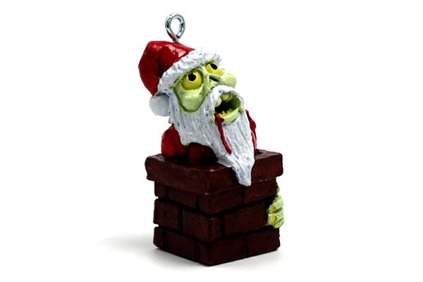 For those of you looking for that special gift, might I suggest this Zombie Santa ornament from Neatoshop.com