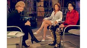 Diane Sawyer doesn't mess around when it comes to the news.   Here she is interviewing Michael Jackson.  She was so glad that she thought better of wearing her own gold-plated catcher's shin guards - that would have been SO embarrassing!  (Image from bet.com)