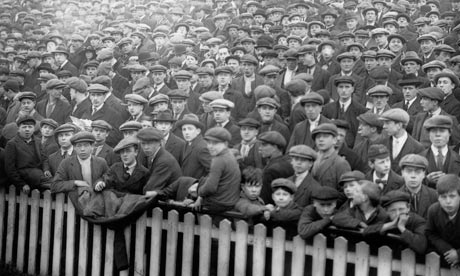 There's me with my little brother Chris.  If we got to the games early enough, we could get a spot near the fence.  It was easy to recognize our favorite players, since there were no facemasks on their leather helmets (Image from guardian dot co dot com)