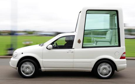 This is the Pope Mobile from Mercedes.  There was big pressure to use Fiat or Lamboghini, but hey, he's a Pope, not a contortionist, am I right?  (Image from telegraph dot co dot uk)