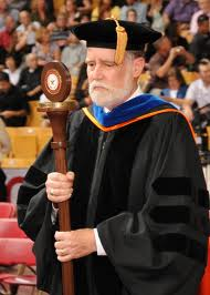 Being the commencement speaker does not give you the right to hold the magic sceptor.  I found this out the hard way, and I'd like to take a moment to apologize to Dean Conroy for the misunderstanding and wish him a speedy recovery.  (Image from txstate dot edu)