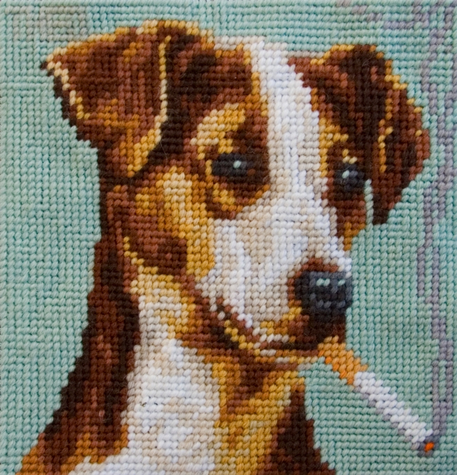 Eddie liked to unwind when the cmeras were off, have a smoke and kick his paws up.  (Image from jackrusseldog dot net)