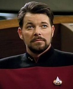"Apparently, this is Will Riker.  Even if I did watch space fiction, I don't think I could look at that mug for too long.  He has the smug, quasi intellectual look of a guy who teaches romance languages down at the community college.  I imagine his dog has that ""cat turds won't melt in my mouth"" look.  (Image from en dot Wikipedia dot org)"