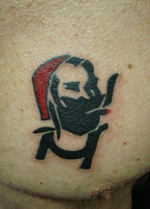 That's not a zit; Zig Zag Man's spleef is all sparked up.  (Image from hellnbak at deviantart dot com)