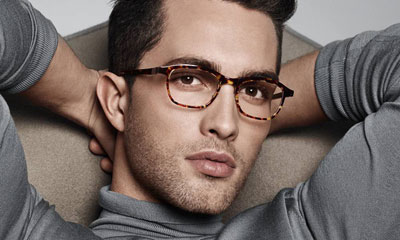 Now that I have the attention of the women and gay men in my reading audience, allow me to assure you I don't look like this young stud, with or without glasses.  If you actually think a guy as perfect as this doesn't have 20/20 vision, you're delusional enough to go eye glass shopping with me.  (Image from fanpop dot com)