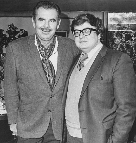 A young Roger Ebert with Russ Meyer.  This serves as an example of why I also avoid sweater vests.  On a personal note, I was always more of a Siskel man myself.  (Image from wikimedia commons)