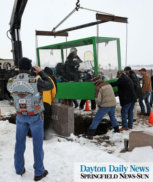 If the sight of a dead guy on a motorcycle in a big plastic box offends you, then avert your eyes from the picture above.  If you already looked, just pretend you didn't see it. (Image from the Dayton daily news dot com)