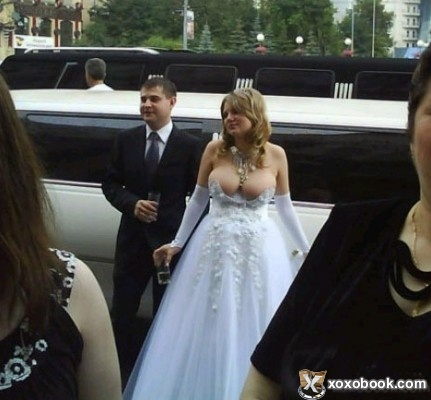 Oh hell no girl!  It's gonna take more than some pink ribbons to fix that dress.  Get your ass back in the limo!  (Image from xoxobook dot com)