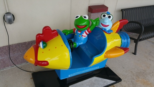 Vehicle design notwithstanding, Baby Kermit exhibits an undeniable lack of any resemblance to Miss Piggy. The one in the back seat is just plain creepy. (Photo by the author) resemblance to