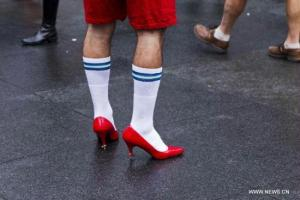 I think the white socks with blue stripes give these get shoes a patriotic look, but my bunions hurt worse than the seeing the ratings of my new TV show. (Image from english dot cntv.cn)