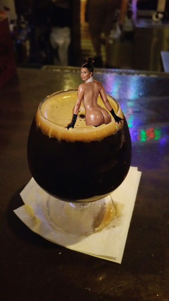 Kim's keister perched on a snifter of imperial stout?  Is this what it takes to get blog hits?